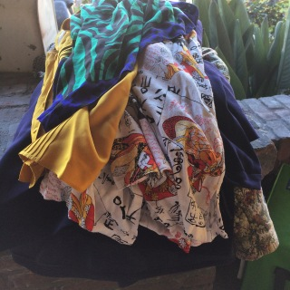 4 jackets, 2 blouses, 1 pair of lacks and a scarf