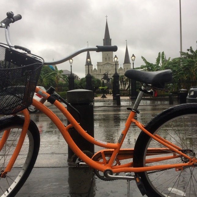 Pausing for a bike portrait in front of Jackson Square